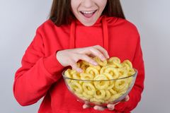 Cropped closeup photo of funny funky excited cheerful pretty with open mouth teen person people taking full plate with hand. Isolated gray background royalty free stock image