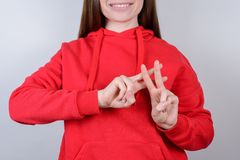 Cropped closeup photo portrait of positive charming pretty beautiful teen teenager human give make hashtag signal gray. Background stock photo