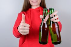 Cropped closeup photo of positive cheerful pretty confident satisfied advertising millenial use thumbup hold glass in hand stock images