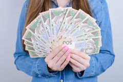 Cropped closeup photo of ukraine money holding in hands beautiful lady  grey background stock photography