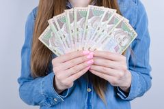 Cropped closeup photo of ukraine money holding in hands beautiful lady  grey background royalty free stock images