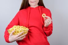 Cropped closeup view photo portrait of funky cool cute teenager youngster looking want tasty rice corn ring licking lips isolated. Gray background royalty free stock photography