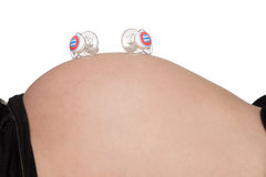 Pregnant belly with two pacifiers Royalty Free Stock Photos