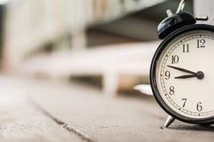 Closeup  vintage alarm clock for time management concept Stock Photos