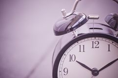 Vintage alarm clock for time management concept Stock Photography
