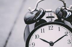 Vintage alarm clock for time management concept Stock Images