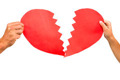 Cropped couple hands holding red cracked heart shape Royalty Free Stock Photos