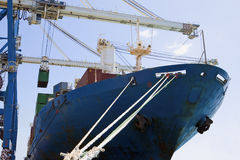 Cropped Cranes By Cargo Containers In Ship Royalty Free Stock Image