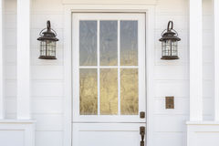 Cropped detail of white door of classic white home Royalty Free Stock Photography