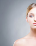 Cropped face of a beautiful woman with blue eyes Stock Image