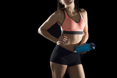 Cropped face body detail portrait of young athletic female body of sport woman bottle water Royalty Free Stock Images