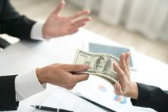 Cropped hand of businessman refusing to take bribe from partner. Outdoors Stock Photography