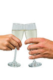 Cropped hand of couple toasting champagne flute Stock Photo