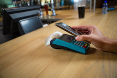 Cropped hand of customer making contactless payment Stock Photo