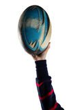 Cropped hand of female athlete holding rugby ball. Against white background royalty free stock photos