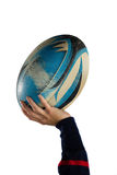 Cropped hand of female athlete playing with rugby ball. Against white background royalty free stock photos