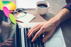 Cropped hand of graphic designer working on laptop Royalty Free Stock Photo