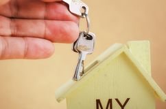 Cropped hand holding bunch of key for home loan and financing. Concept royalty free stock image