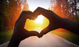 Cropped Hand Making Heart Shape Royalty Free Stock Photos