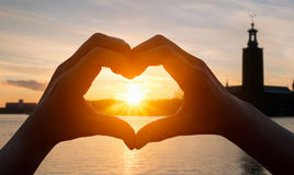 Cropped Hand Making Heart Shape Stock Photography