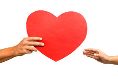 Cropped hand of man giving heart shaped paper to woman Stock Images