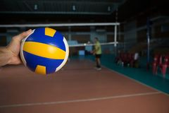 Cropped hand of sportsperson holding volleyball Royalty Free Stock Image