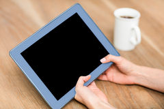 Cropped hand of woman using digital tablet Stock Image