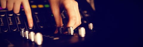 Cropped hands of audio engineer using sound recording equipment Royalty Free Stock Photos