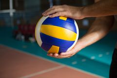 Cropped hands of player holding volleyball Royalty Free Stock Photo