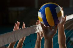 Cropped hands of players practicing volleyball royalty free stock photos