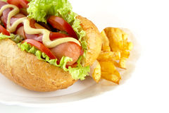 Cropped hot dog with ingredients on plate on white background Stock Photos
