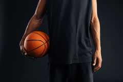 Cropped image of an african basketball player holding ball Royalty Free Stock Photos
