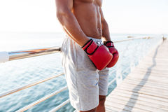 Cropped image of african sportsman in red gloves doing exercises stock photo