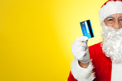Cropped image of aged Santa holding credit card Stock Photo