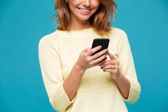 Cropped image of amazing young woman chatting by phone. Cropped image of amazing young woman smile and chatting by phone Royalty Free Stock Images