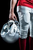 Cropped image of American football player holding helmet Royalty Free Stock Image