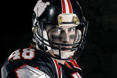 Cropped image of american footballer. Cropped image of american football player Royalty Free Stock Images