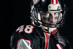 Cropped image of american footballer. Cropped image of american football player Royalty Free Stock Image