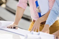 Cropped image of architects with blueprints and clipboard Stock Images