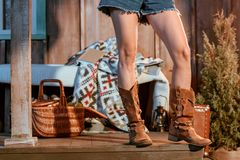 Cropped image of bohemian woman. In brown shoes and jeans shorts stock image