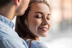 cropped image of boyfriend kissing happy girlfriend stock photos