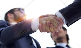 Cropped image of business people shaking hands royalty free stock photo