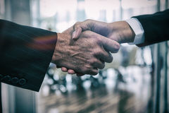 Cropped image of business people shaking hands Stock Image