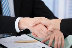 Cropped image of business people shaking hands royalty free stock images