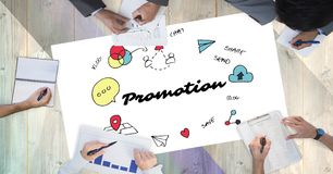 Cropped image of business people working while promotion text surrounded by graphics Stock Photography