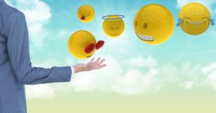 Cropped image of business person standing by various emojis Royalty Free Stock Photography