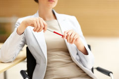 Cropped image of business woman holding a pen Stock Photos
