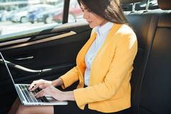 Cropped image of business woman travelling to work Royalty Free Stock Photography