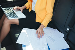 Cropped image of a business woman working with mobile phone Royalty Free Stock Images