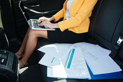 Cropped image of a business woman working with mobile phone Stock Photo